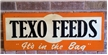 Old Vintage Texo Feeds Metal Sign - Embossed